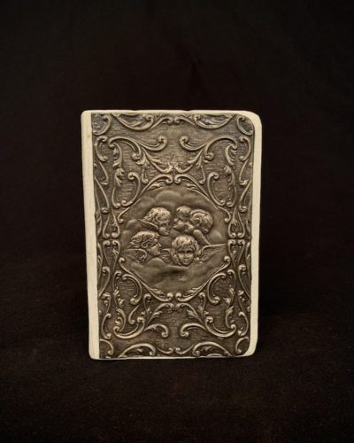 Bible with decorative metal plate