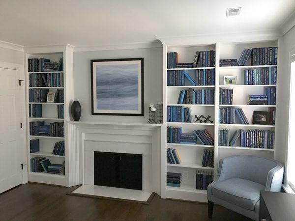 Blue Books on White Shelves